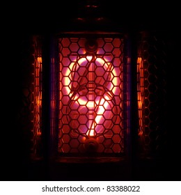 The real Nixie tube indicator of the numbers of retro style. Indicator glow with a magical purple fringing. Digit 9