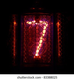 The real Nixie tube indicator of the numbers of retro style. Indicator glow with a magical purple fringing. Digit 7