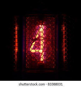 The real Nixie tube indicator of the numbers of retro style. Indicator glow with a magical purple fringing. Digit 4