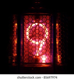 The real Nixie tube indicator of the numbers of retro style. Indicator glow with a magical purple fringing. Digit 9 and the point
