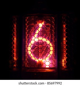The real Nixie tube indicator of the numbers of retro style. Indicator glow with a magical purple fringing. Digit 6 and the point