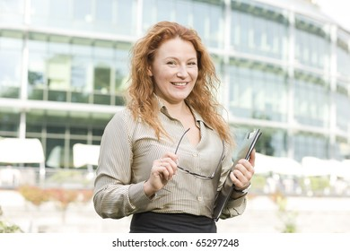 Real office worker posing for camera outdoor