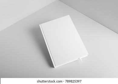 Real photo, blank book, brochure, booklet mockup template, hard cover, isolated on light grey background to place your design.