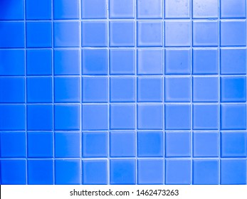 real photo of blue square mosaictiles tiles wall or floor of the bathroom