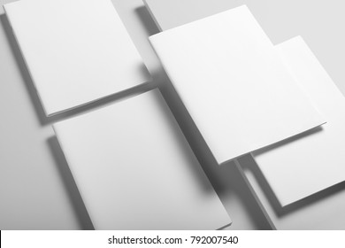 Real photo, brochure mockup template, softcover, collage, stack, isolated on light grey background to place your design.