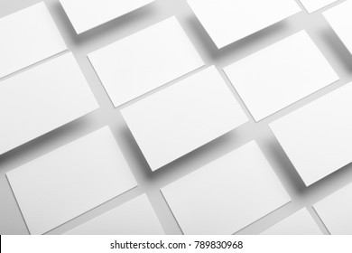 Real photo, business card collage mockup template, isolated on light grey background to place your design.