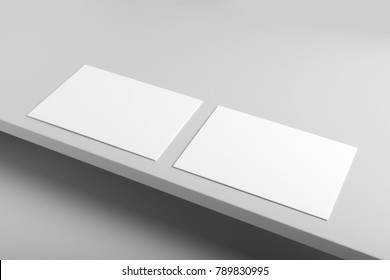 Real photo, business card mockup template, isolated on light grey background to place your design.