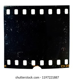 Real photo of dirty and grungy 35mm film frame on white