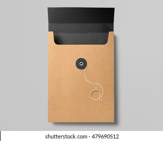 Real photo, open cardboard envelope, isolated on grey to replace your design. With clipping path, isolated, changeable background.
