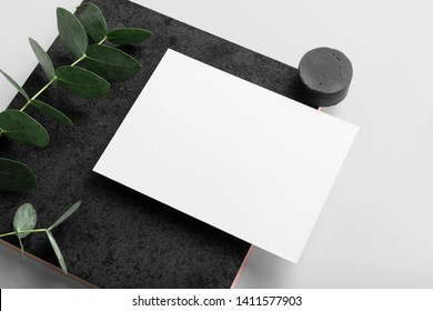 Real photo, stationery branding mockup template to place your design, isolated on light grey background, with concrete, copper, granite and floral elements.