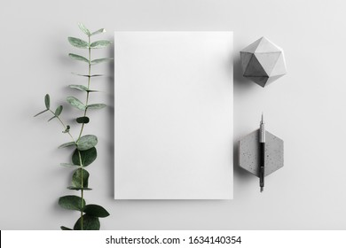 Real photo, stationery branding mockup template to place your design, isolated on light grey background, with concrete, copper, granite and floral elements. - Shutterstock ID 1634140354