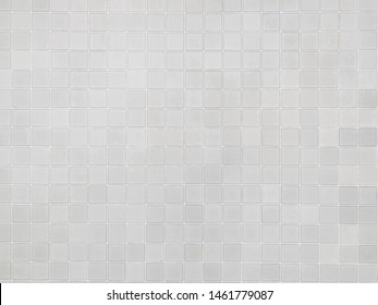 real photo of white gray  square mosaictiles wall of the bathroom