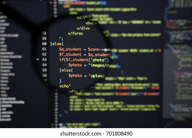 Real Php code developing screen. Programing workflow abstract algorithm concept. Lines of Php code visible under magnifying lens.