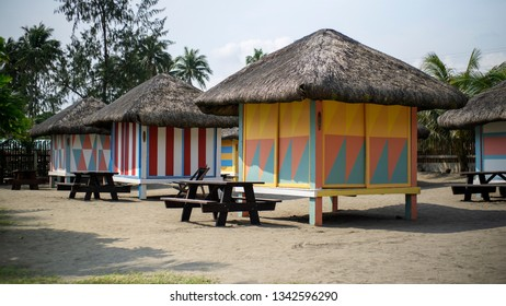 Real, Quezon, Philippines - March 12, 2019: Several colorful cottages in a beach resort for tourists in Real, Quezon, Philippines.