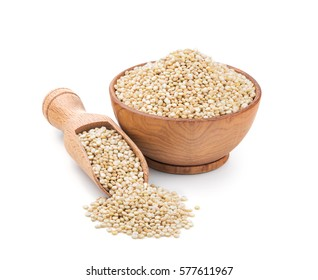 Real quinoa in a wooden bowl isolated on white