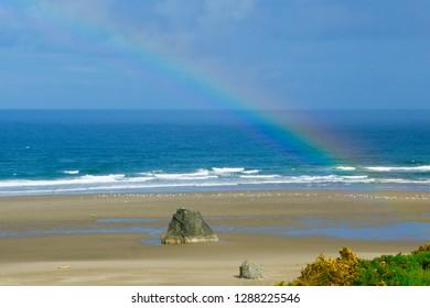 Real rainbow over Pacific Northwest Oregon beach
