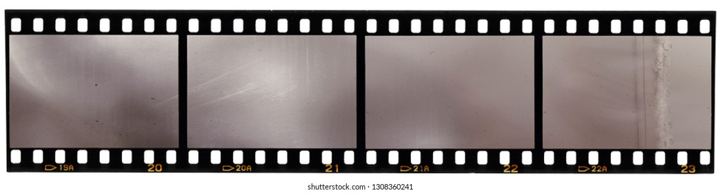 real scan of 35mm film strip or film material isolated on white background, just blend in your own content to make it look old and vintage