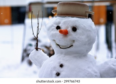 A real snowman. Detail of a head with a carrot and a pot