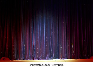 real stage curtain and microphones backdrop