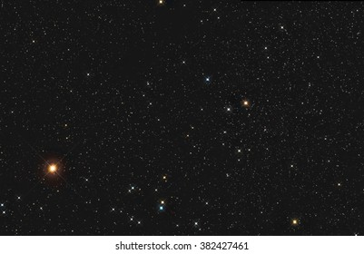 Real star cluster Hyades cluster with bright orange star Aldebaran in Taurus taken with CCD camera and telescope two frames mosaic