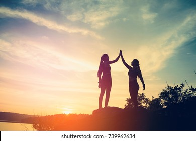 real success story in the mountain,sport couple woman with successful with sunset