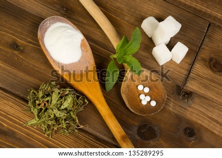 Real sugar lumps and stevia in powder dried and tablet form