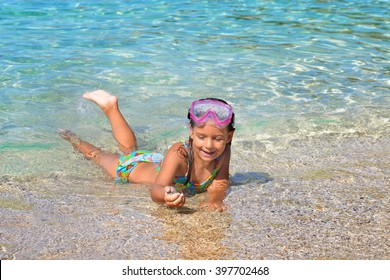 Real toddler girl enjoying her summer vacation at beach