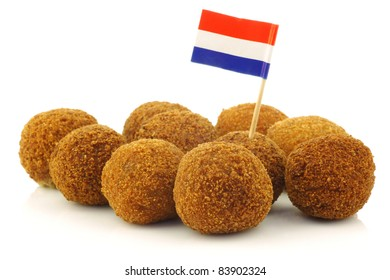 "A real traditional Dutch snack called ""bitterballen"" with a Dutch flag toothpick on a white background"