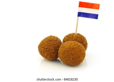 """A real traditional Dutch snack called """"bitterballen"""" with a Dutch flag toothpick on a white background"""