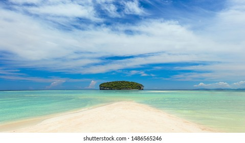 Real Tropical Island with clear water and white sand beach