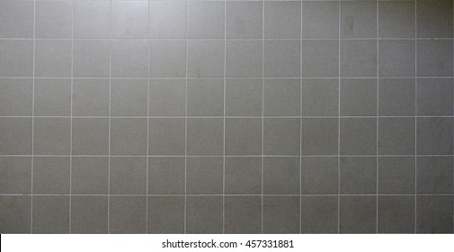 Real wall gray tiles background and texture.