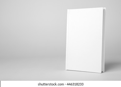 Real white book on a gray background