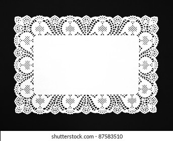 Real White Doily isolated on black background