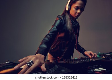 real woman dj playing music at party
