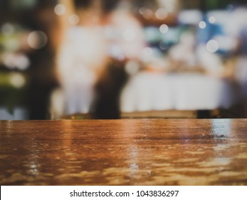 Real wooden table bar in front of burred windows and bohek background at restaurant