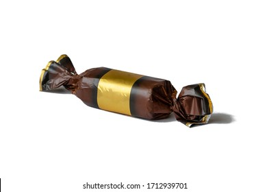 Real wrapped chocolate candy on a white background. A single candy in brown with a gold foil wrapper. Place for text. Isolate on a white background.