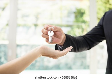 Real-estate agent giving keys to new property owners