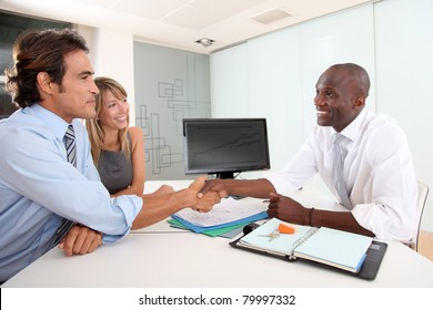 Real-estate agent shaking hand to house buyer