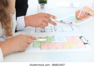 Real-estate agent showing house plans