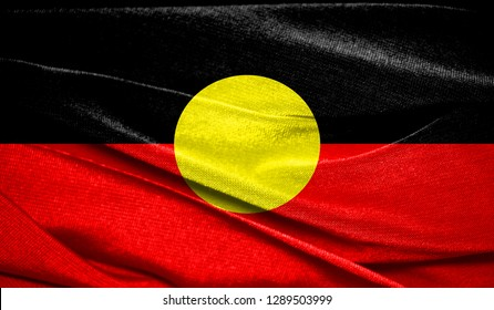 Realistic flag of Australian Aboriginal on the wavy surface of fabric. Perfect for background or texture purposes