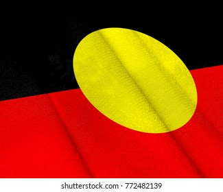 Realistic flag of Australian Aboriginal on the wavy surface of fabric