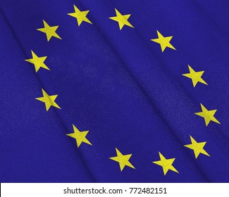 Realistic flag of European Union on the wavy surface of fabric