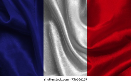 Realistic flag of France on the wavy surface of fabric. This flag can be used in design.