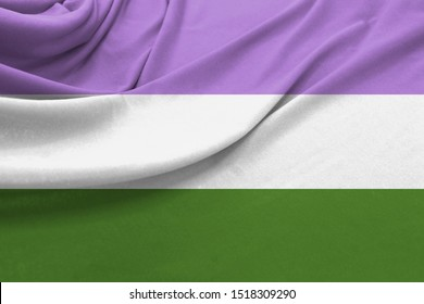 Realistic flag of genderqueer pride on the wavy surface of fabric