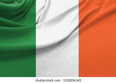 Realistic flag of Ireland on the wavy surface of fabric