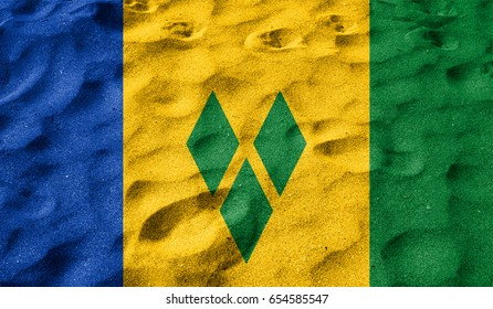 Realistic flag of Saint Vincent and the Grenadines on the wavy surface of fabric. This flag can be used in design