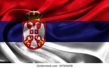 Realistic flag of Serbia on the wavy surface of fabric. This flag can be used in design