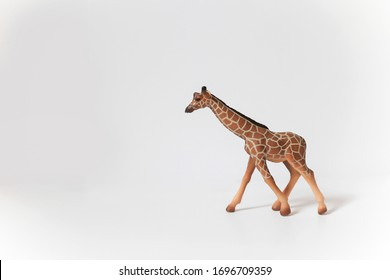 realistic giraffe toy on a white background