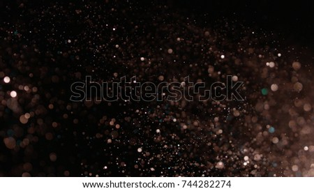 Realistic Glitter Exploding On Black Background Stock Photo