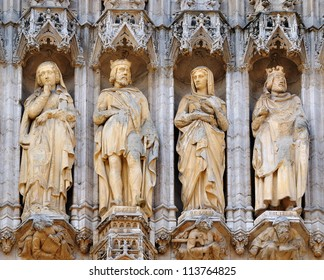 Realistic gothic statues decorating medieval facade of Grand Place in Brussels, Belgium